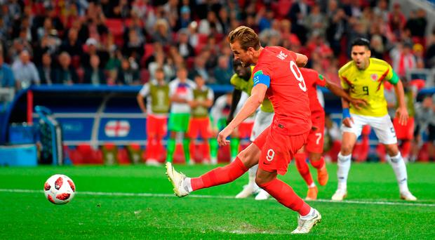 First blood: Harry Kane puts England in front with a penalty