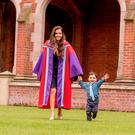 Erika Jimenez, who will be awarded her degree from the School of Social Sciences, Education and Social Work today, with her two-year-old son Job