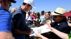 Rory McIlroy signing autographs for fans at today's Pro-Am at the Dubai Duty Free Irish Open in Ballyliffin, Donegal.