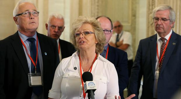 Julie Hambleton, whose sister Maxine died in the Birmingham pub bombings, speaking to the media in the Great Hall at Stormont (Brian Lawless/PA)