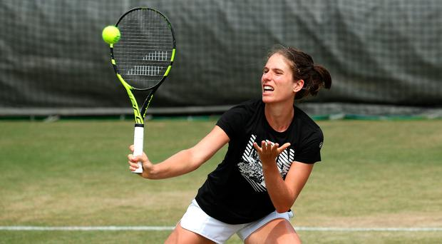 Good connection: Johanna Konta in practice at Wimbledon ahead of her second-round date with Dominika Cibulkova