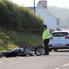 Garda at the scene of the accident on the main Londonderry to Buncrana Road, on the outskirts of the village of Fahan