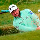 Digging deep: Graeme McDowell came back from a dismal start