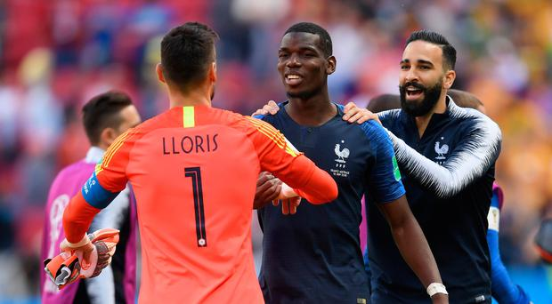 French flair: Keeper Hugo Lloris celebrates with team-mates Paul Pogba and Adil Rami of France