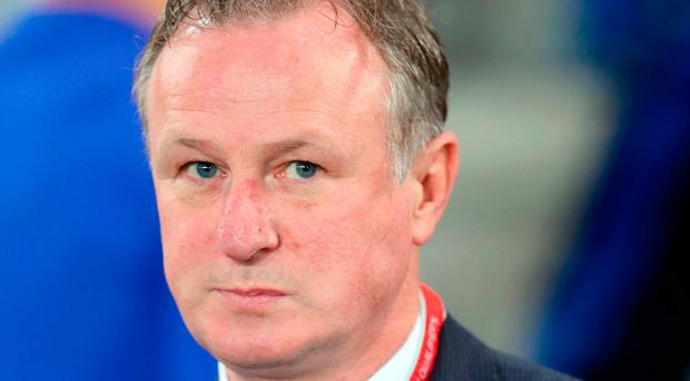 Tough call: Michael O'Neill is backing Brazil to lift trophy