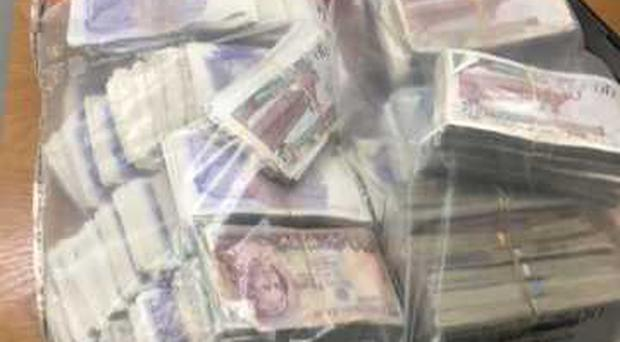 A large quantity of cash was seized.