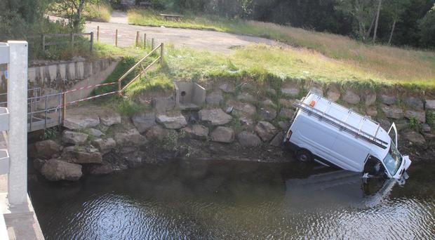 A van ends up in a river near Greysteele on Friday evening after a collision with a tractor and trailor. PICTURE MARK JAMIESON.