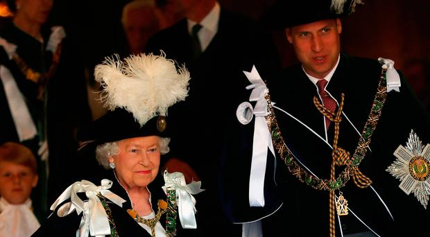 The Queen and the Duke of Cambridge attending the Order of the Thistle Service at St Giles' Cathedral in Edinburgh