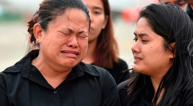 Family members grieve for the diver who died during the cave operation