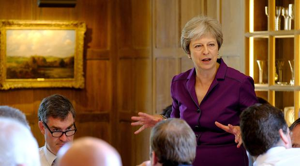 Prime Minister Theresa May speaks during a cabinet meeting (Joel Rouse/Crown Copyright/PA)