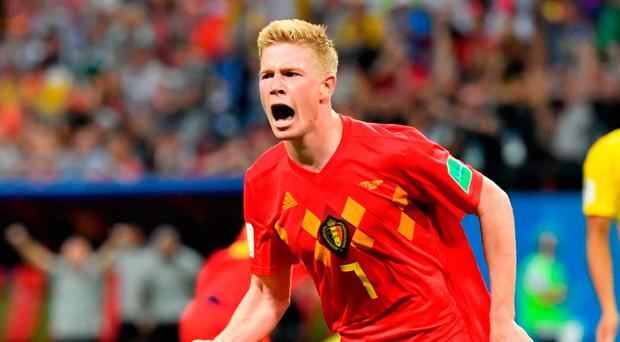 Class apart: Kevin de Bruyne roars with delight after scoring Belgium's second against Brazil