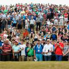 Rory McIlroy tees off in front of a packed gallery at the Irish Open.