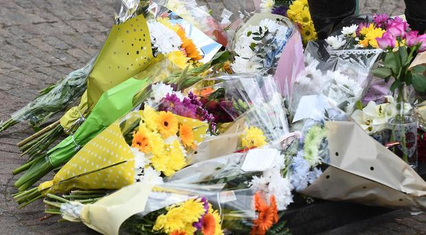 Flowers left at the Dunlop Memorial garden in Ballymoney on sunday for road racer William Dunlop Pic Colm Lenaghan/Pacemaker