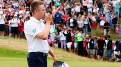 Scotland's Russell Knox celebrates winning the play-off with his second drained putt in a row.