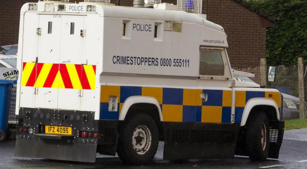 Police landrovers have moved into the Fountain Estate in an attempt to prevent further violence. Credit: PSNI