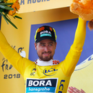 Pack leader: Three-time world champion Peter Sagan poses in the famous yellow jersey after taking the overall Tour lead