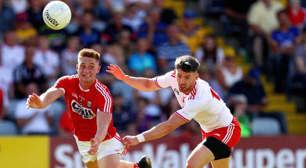 Man on: Cork's Kevin Flahive is challenged by Matthew Donnelly
