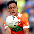 Forward thinking: Jemar Hall launches an Armagh attack