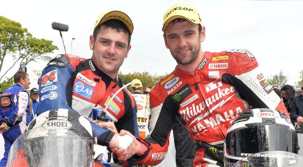 Sibling rivals: Brothers Michael (MD Racing Honda) and William Dunlop (Milwaukee Yamaha) in the winners enclosure after finishing first and third in the Supersport race at the 2013 Isle of Man TT