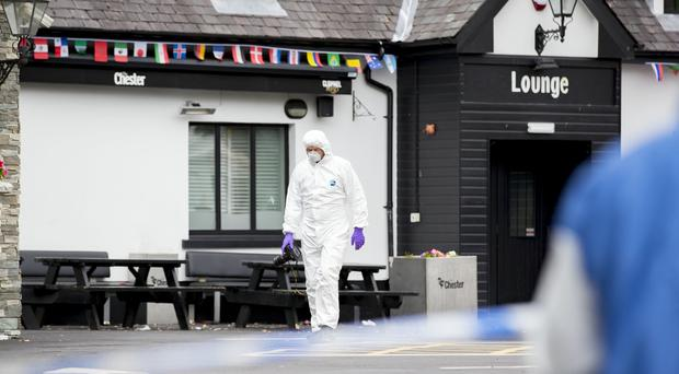 Forensic officers gather evidence at the Chester Bar on the Antrim Road in Belfast on July 9th 2018 (Photo by Kevin Scott for Belfast Telegraph)