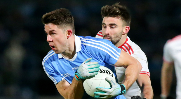 Man on: Tyrone's Tiernan McCann and Dublin's David Byrne during the NFL clash in Omagh
