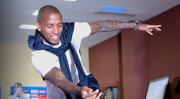 On a roll: Ashley Young tries his hand at a spot of bowling