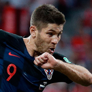 Letting fly: Croatia ace Andrej Kramaric shoots against Russia