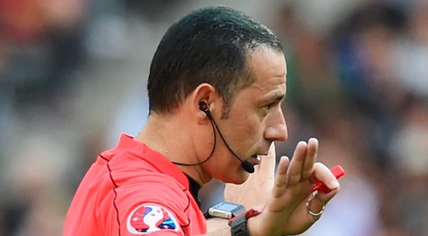 Referee Cuneyt Cakir