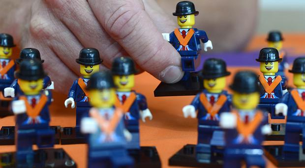 Pacemaker Press Belfast 05-07-2018: David Scott pictured with Orange Men made of Lego pictured in the shop at the Grand Orange Lodge of Ireland and Museum of Orange Heritage in Belfast. Picture By: Arthur Allison.