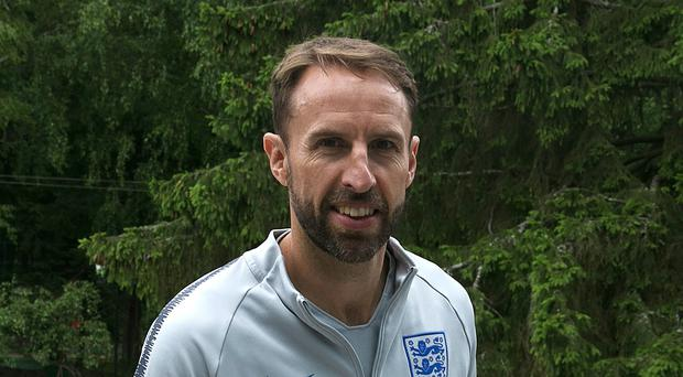Gareth Southgate will lead England into a World Cup semi-final with Croatia (Owen Humphreys/PA)