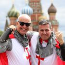 England fans Dexter Marshall and Miles Rudham (right) are getting into the mood in Red Square (Aaron Chown/PA)