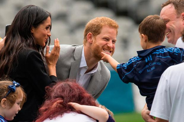 A boy strokes the Duke of Sussex's beard, during a visit to Croke Park, on day two of their visit to Dublin, Ireland (Dominic Lipinski/PA Wire)