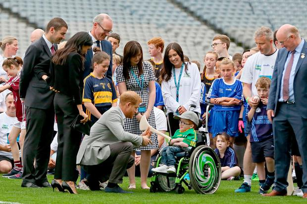 Britain's Prince Harry, Duke of Sussex (centre left) chats with a young boy in a wheelchair during a visit with Meghan, Duchess of Sussex (2nd L) to Croke Park (Getty Images)