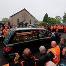 The cortege arrives at Garryduff Presbyterian Church, Ballymoney, Co Antrim, for the funeral of motorcycle racer William Dunlop. PRESS ASSOCIATION Photo.