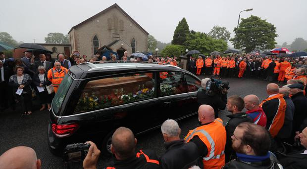 The cortege arrives at Garryduff Presbyterian Church, Ballymoney, Co Antrim, for the funeral of motorcycle racer William Dunlop (Niall Carson/PA)
