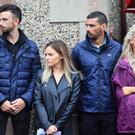 Racers Glenn Irwin and Derek Sheils along with their partners Laura and Alicia paying their respects at William Dunlop's funeral.