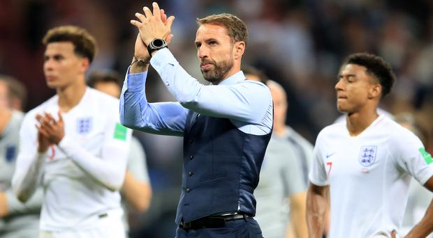 England manager Gareth Southgate applauds the fans after his side's defeat to Croatia in World Cup semi-final (Adam Davy, PA)