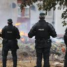 Police at the site of a bonfire in the Bloomfield Avenue area of Belfast (Niall Carson/PA)
