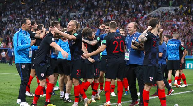 Croatia players celebrate reaching the final (Tim Goode/PA)