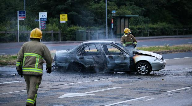 A car burns in in East Belfast this evening on the Upper Newtownards Road. Photo by Kelvin Boyes / Press Eye.