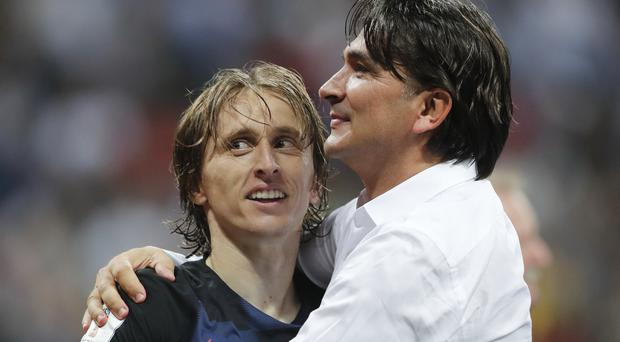 Luka Modric, pictured left, will lead Croatia into Sunday's final (Frank Augstein/AP)