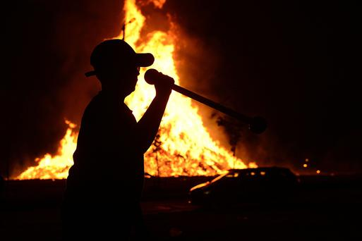 People pictured enjoying the Kilcooley bonfire in Bangor Co Down, Northern Ireland. Pacemaker: Arthur Allison.