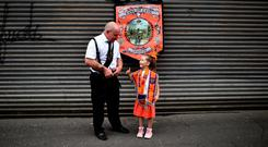 Abby Preston, aged five watches on during the annual 12th of July Orange march and demonstration taking place on July 12, 2018 in Belfast (Photo by Charles McQuillan/Getty Images)