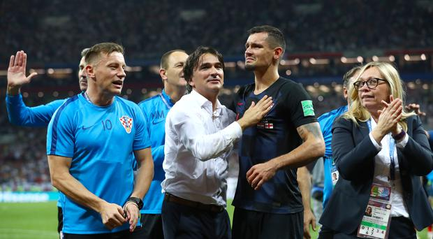 Dejan Lovren and Croatia manager Zlatko Dalic celebrate after the final whistle (Tim Goode/PA)
