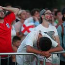 England fans in Nottingham look downcast after the defeat to Croatia (David Davies/PA)