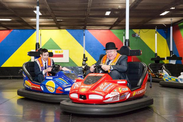Grand Secretary of the Grand Orange Lodge of Ireland, Rev Mervyn Gibson, and Castlewellan District Master, Trevor Orr, enjoying the dodgem cars at the Newcastle Twelfth