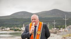 Grand Secretary of the Grand Orange Lodge of Ireland, Rev Mervyn Gibson, enjoys ice cream in the shadow of the Mournes at the Twelfth in Newcastle.