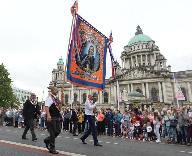 Thousands of People line the streets of Belfast to celebrate the annual 12th of July celebrations, As Orange men and bands parade through Belfast City Centre on Thursday. Pic Pacemaker