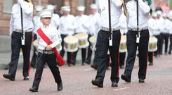 Bandsmen and Orange order members take part in the annual Twelfth of July celebrations in Belfast city centre (Niall Carson/PA)