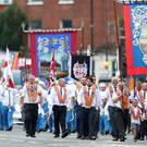 Bandsmen and Orange order members take part in the annual Twelfth of July celebrations (Niall Carson/PA)